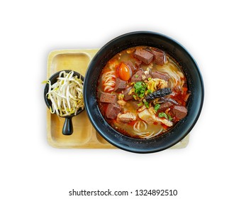 Khanom Jin Nam Ngiao or rice noodles with spicy chicken sauce on white background with clipping path.Bowl of spicy noodle soup, northern of thailand style cuisine (Khanom Jin Nam Ngiao)