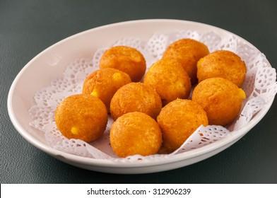 Khanom kai nok krata or deep-fried sweet potato balls