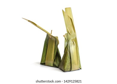 Khanom Sai Sai thai dessert (stream flour with coconut filling wrapping in banana leaf) on white background for text