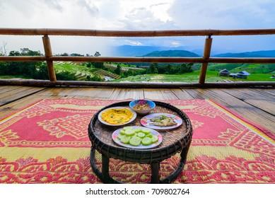 Khantok (food tray) Thai food traditionally dinner for homestay at Pa Pong Pieng homestay, Mae Chaem, Chiang Mai, Thailand.
