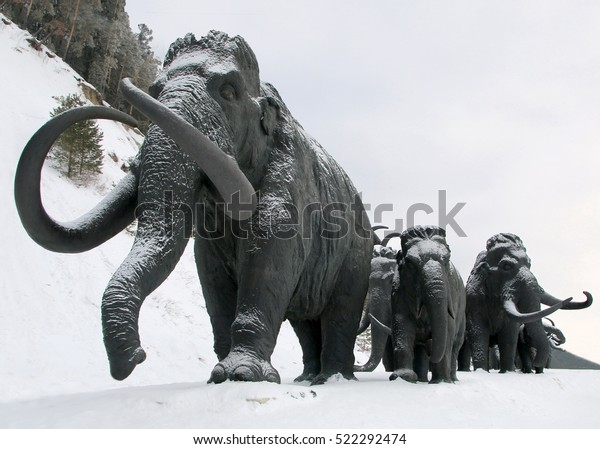 Khanty - Mansiysk,Russia - MARCH 17: Sculptures of mammoths on March 17, 2016 in Archeopark. Located at the foot of glacial hill, Archeopark shows lifelike statues of prehistoric animals and humans.