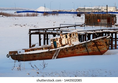 Khanty-Mansiysk. Western Siberia. Russia. January 20.2012. Decommissioned scrap boat on the banks of the river Irtysh frosty morning.