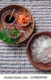 Khao Kriab Yana local snack of Ban Nam Chiao, Trat, Thailand Street food crispy rice snack with shredded coconut, shrimp and sugar cane syrup