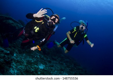 KHAO LAK, THAILAND - NOEVMEBER 24: Scuba dive guide leading a senior female diver in Similan Islands on November 24, 2009 . Similan Islands are Thailand's premier dive destination.