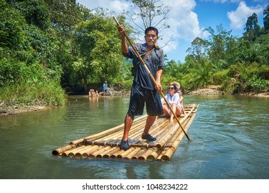 KHAO LAK/THAILAND - February 7, 2012: Thai boatmen rafting tourists with the pole in Khao Lak national park