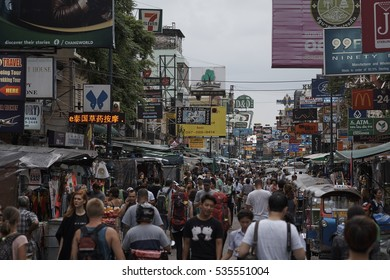 KHAO SAN ROAD, BANGKOK, THAILAND - SEPTEMBER 2016: Tourists strolling along famous Khao San Road at dusk, the backpacker center of Bangkok.
