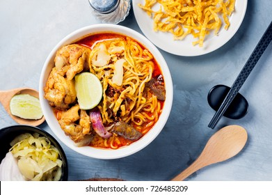Khao Soi Kai, Northern Style Egg Noodle in Chicken Curry With Ingredients. Thai Food