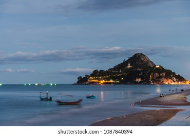 Khao Takieb beach in the evening, with the boats at shore and the temple in the background, Huahin Thailand