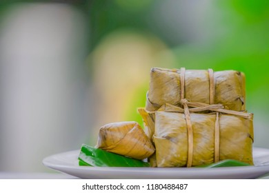 Khao tom pronounced  also spelled kao tom), or khao tom mat  pronounced  is a Laotian and Thai dessert of seasoned steamed sticky rice wrapped in banana leaves.Other names include khao tom mad,