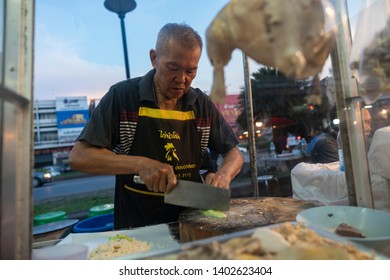 Khao Yai, Pak Chong / Thailand - May 19, 2019 : A local Thai vendor prepares chicken rice dish. Pak Chong night market is an attraction that sits close to the Khao Yai national park
