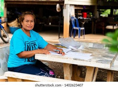 Khao Yai, Pak Chong / Thailand - May 20, 2019 : A local of Pak Chong working and smiling for the camera. Pak Chong is the largest district of Nakhon Ratchasima and part of Thailand's largest national