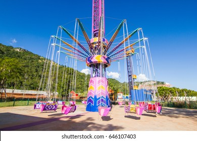 """Khao Yai,  Thailand : - November 21, 2015. This is  """"Typhoons Tower""""  in The park amusement park in nature. has mountains behind. A popular tourist attraction."""