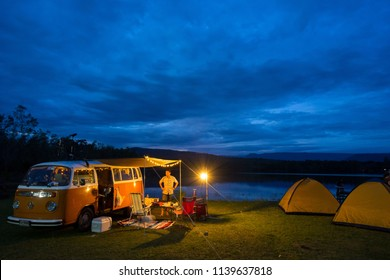 KHAO-ITO, THAILAND - December 04 2017: Family travel camping near swamp in sky night with classic van, Asian travel picnic near swamp in holiday trip.