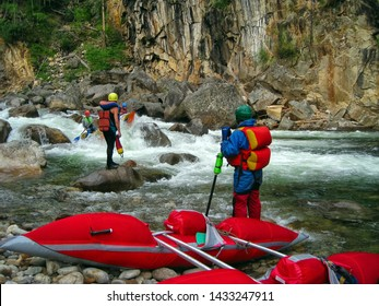 The Khara-Murin River, Republic of Buryatia, Russia - July 30, 2009: a group of extreme athletes crosses the river on catamarans. Categorical rafting on a mountain river.