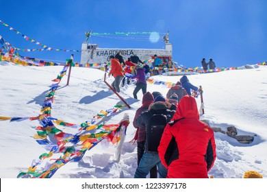 KHARDUNG LA, LADAKH, INDIA - SEPTEMBER 28, 2018: Tourists are traveling on the top of mountain at Khardung La Pass, the highest motor able pass on the world.. Ladakh, Jammu and Kashmir, India