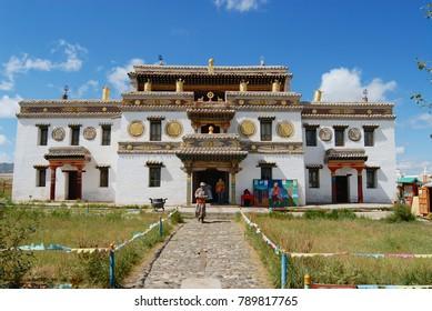 KHARKHORIN, MONGOLIA - AUGUST 22, 2006: Unidentified Mongolian people visit Erdene Zuu monastery in Kharkhorin, Mongolia. Erdene Zuu monastery is a UNESCO World Heritage site.