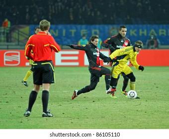 KHARKIV, UA - FEBRUARY 17: FC Metalist Kharkiv MF Serhiy Valyayev (R) in action during Europa League football match vs. Bayer 04 Leverkusen, on February 17, 2011 in Kharkiv, Ukraine