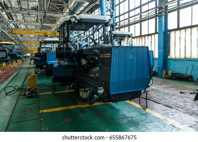 KHARKIV, UKRAINE - 07 JUNE, 2017: Conveyor assembly stage the body of tractor at KhTZ factory