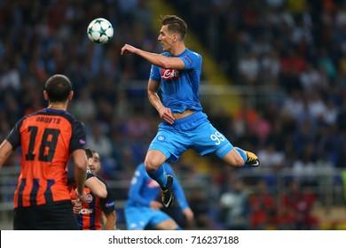 KHARKIV, UKRAINE - 13 SEPTEMBER, 2017: Arkadiusz Milik performs spectacular header shot. Champions League. Shakhtar - Napoli. Metalist stadium