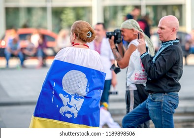Kharkiv, Ukraine - 17 May 2018 : Girl holding ukrainian flag with portrait of Taras Shevchenko standing with photografers looking at embroidered shirt holiday in Kharkiv