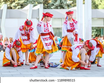 Kharkiv, Ukraine - 17 May 2018 : schoolage girls in pretty unkrainian national suits prepearing for perfomance on embroidered shirt holiday in Kharkiv
