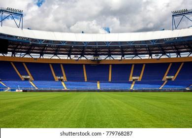 """KHARKIV, UKRAINE - 24.06.2017: Empty stadium """"Metalist"""". Panoramic view from the pitch."""
