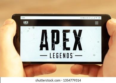 Kharkiv, Ukraine - 31 March, 2019:Hands holding a smartphone with apex legends registration website