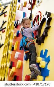 Kharkiv, Ukraine, April 22, 2016: Peak - climbing center. Climbing wall for children. The parkour Park, climbing wall and trampolines. The little girl on the climbing wall.