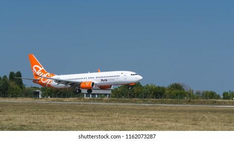 Kharkiv, Ukraine - August 19 2018: Boeing 737-800 of  Ukrainian low-cost carrier SkyUp Airlines is landing. Plane just above the runaway.