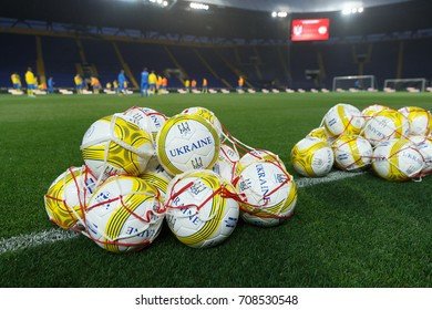 KHARKIV, UKRAINE - AUGUST 29, 2017: Souvenir football balls titled Ukraine on the green pitch. Open training before FIFA World Cup 2018 Qualifying match Ukraine-Turkey. OSC Metalist Stadium.