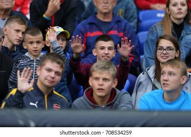 KHARKIV, UKRAINE - AUGUST 29, 2017: Fans on the stands. Open training before FIFA World Cup 2018 Qualifying match Ukraine-Turkey. OSC Metalist Stadium.