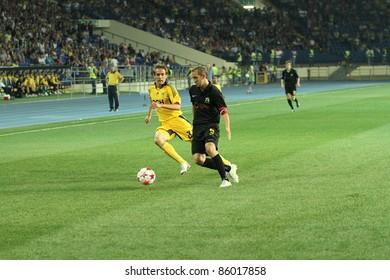 KHARKIV, UKRAINE - AUGUST 6: FC Metalist Kharkiv FW Marko Devich (L) in action during football match vs. PFC Oleksandria (2:1), August 6, 2011 in Kharkov, Ukraine