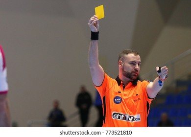 KHARKIV, UKRAINE - DECEMBER 03, 2017: Serbian official. Referees Dejan Markovic shows yellow card. EHF Men's Champions League. HC Motor Zaporozhye - Montpellier HB