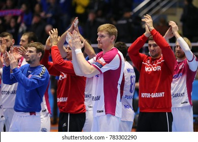 KHARKIV, UKRAINE - DECEMBER 03, 2017: Motor Zaporozhye team applauding to fans celebrating impressive win over Montpellier. EHF Men's Champions League. HC Motor Zaporozhye - Montpellier HB