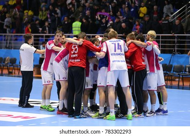 KHARKIV, UKRAINE - DECEMBER 03, 2017: Motor Zaporozhye team. Players celebrating impressive win over Montpellier. EHF Men's Champions League. HC Motor Zaporozhye - Montpellier HB
