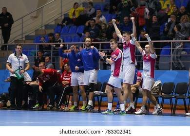 KHARKIV, UKRAINE - DECEMBER 03, 2017: Motor Zaporozhye team bench players celebrating scored goal. EHF Men's Champions League. HC Motor Zaporozhye - Montpellier HB