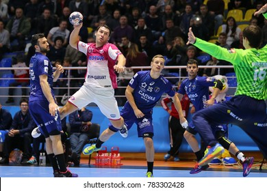 KHARKIV, UKRAINE - DECEMBER 03, 2017: PUKHOUSKI Barys flying amazingly one-on-one with goalkeeper and throws the ball. EHF Men's Champions League. HC Motor Zaporozhye - Montpellier HB