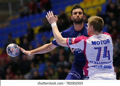 KHARKIV, UKRAINE - DECEMBER 03, 2017: SOUSSI Mohamed close-up portrait passing the ball in pressing. EHF Men's Champions League. HC Motor Zaporozhye - Montpellier HB