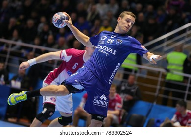 KHARKIV, UKRAINE - DECEMBER 03, 2017: FAUSTIN Jean Loup throws the ball performing the powerful shot. EHF Men's Champions League. HC Motor Zaporozhye - Montpellier HB