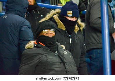 KHARKIV, UKRAINE - December 06, 2017: Fans of Manchester City in the stands with flags during the UEFA Champions League match between Shakhtar Donetsk vs Manchester City, Ukraine