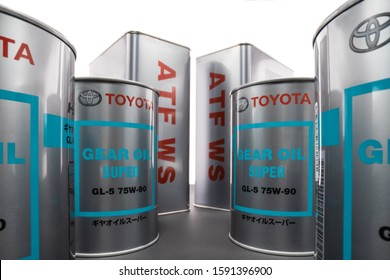 KHARKIV, UKRAINE - DECEMBER 12, 2019: Shooting on wide angle metal cans with transmission synthetic oil Toyota GEAR OIL SUPER 75W-90 GL-5 and ATF WS. Trademark owned by the Toyota Motor Corporation.