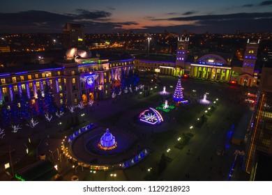 Kharkiv, Ukraine - December 30: Aerial view of night Kharkiv railway station square during Christmas. Night view of Chirstmas decorations in Kharkiv.