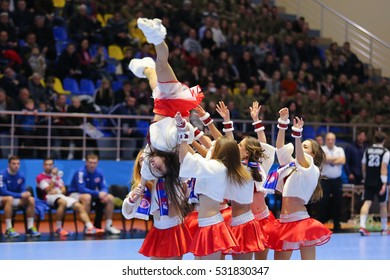 "KHARKIV, UKRAINE - DECEMBER 4, 2016: Cheerleaders dancing. EHF Men's Champions League match HC Motor Zaporozhye vs Besiktas Mogaz HT, Palace of Sports ""Lokomotiv"""