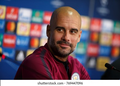 KHARKIV, UKRAINE - DECEMBER 5, 2017: Josep Guardiola smiles. Close-up portrait at pre-match press-conference. UEFA Champions League game Shakhtar Donetsk and Manchester City at OSC Metalist stadium
