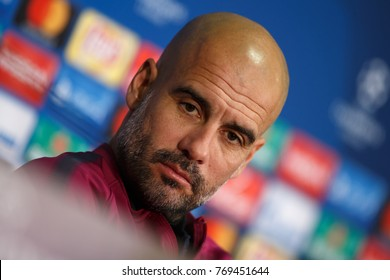 KHARKIV, UKRAINE - DECEMBER 5, 2017: Josep Guardiola close-up portrait at press-conference. Looks seriously into camera. UEFA Champions League game Shakhtar Donetsk and Manchester City