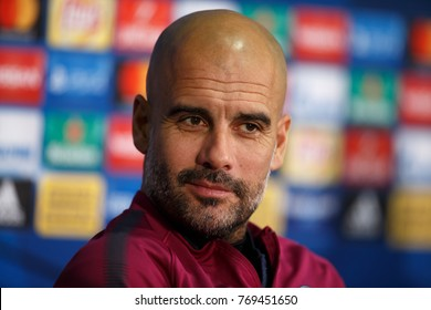 KHARKIV, UKRAINE - DECEMBER 5, 2017: Josep Guardiola smiles and looking serious. Close-up portrait at press-conference. UEFA Champions League game Shakhtar Donetsk and Manchester City