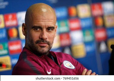 KHARKIV, UKRAINE - DECEMBER 5, 2017: Josep Guardiola smiles and looking serious. Close-up portrait at press-conference. UEFA Champions League game Shakhtar Donetsk and Manchester City at Metalist