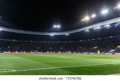 KHARKIV, UKRAINE - DECEMBER 6, 2017: Metalist stadium panoramic photo during the match with the light on stands. UEFA Champions League. Shakhtar Donetsk - Manchester City