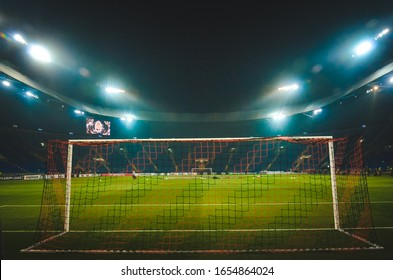 KHARKIV, UKRAINE - Febriary 20, 2020: General view of the football stadium in Kharkov Osk Metalist from the inside behind the gate during the UEFA Europe League match, Ukraine