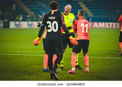 KHARKIV, UKRAINE - Febriary 20, 2020: Shakhtar footballers argue with referee Bobby Maddenduring the UEFA Europe League match between Shakhtar Donetsk vs SL Benfica, Ukraine